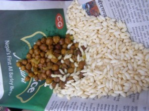 Eating a Nepali snack of yummy rice krispies and chickpead