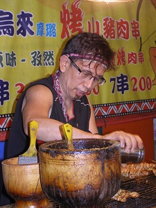 Warrior Dancer Cooking Wild Boar at Walui
