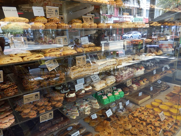 A shop window full of yummy cakes.