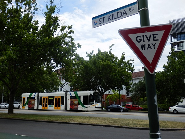 St Kilda Road sign and tram