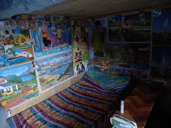 Nepal - room in tea house with pictures of bollywood stars covering the walls