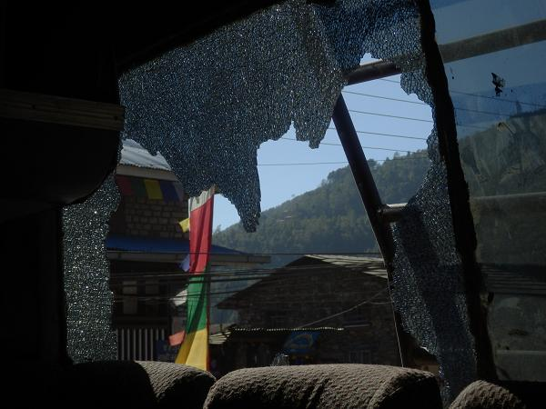 Nepal - Back window shattered by rock