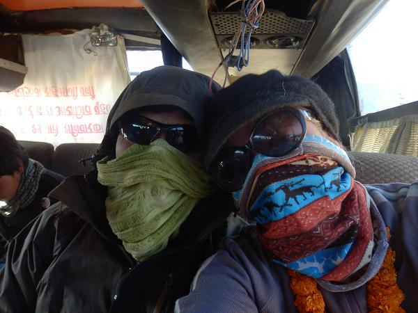 Nepal - On a Nepali bus wearing masks to protect ourselves from the dust.