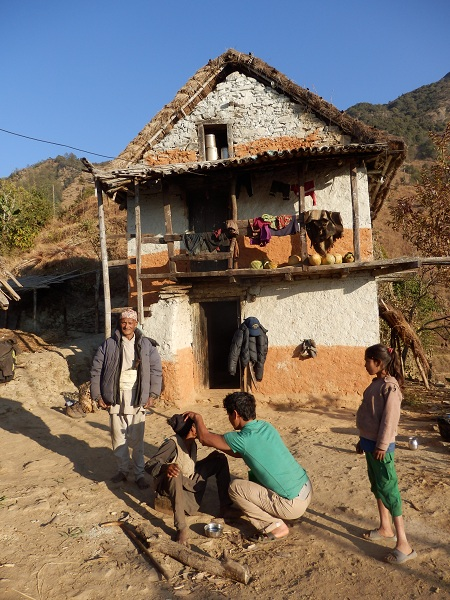 A typical Himalayan house with Gele shaving a relative