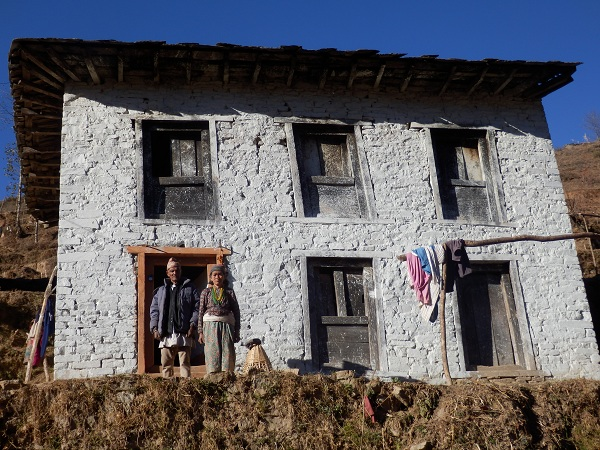 Nepal - A typical stone Himalayan house with Gele's parents standing outside