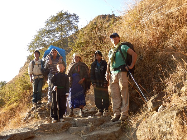 Nepal - On the side of a mountain in the Himalayas with my guide, porter and some locals