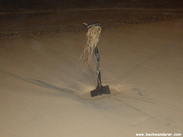 A shovel in the sand used to determine where the tide was