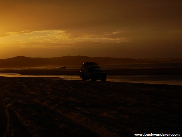 Sunset with a 4WD at Waddy Point, Fraser Island
