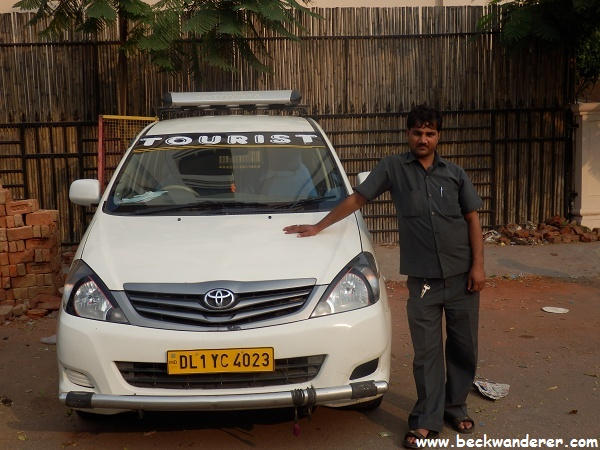 Our driver standing outside an Innova
