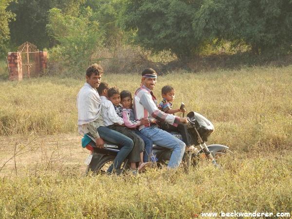 6 people on a motor bike