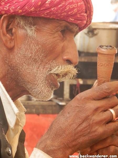 Close up of camel owner with pipe, Pushkar Camel Fair