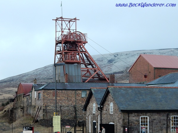 The entrance to the Big Pit with mountains with snow on