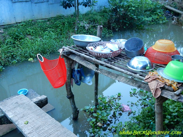 Homestay Kitchen - a wooden table over the river