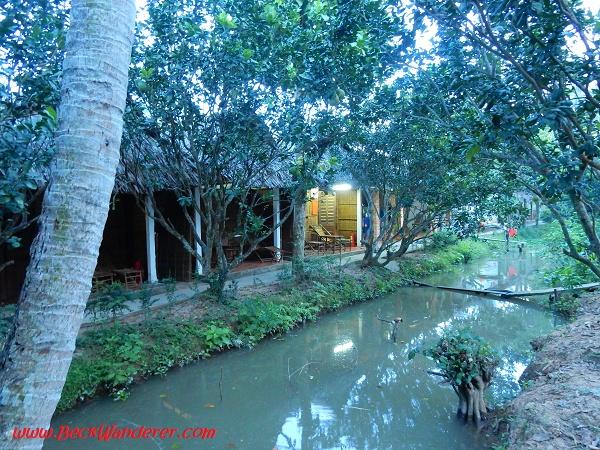 Homestay wooden hut alongside the Mekong Delta