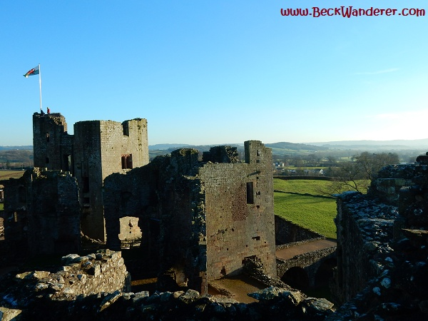 Raglan Castle with a view of the Welsh countryside