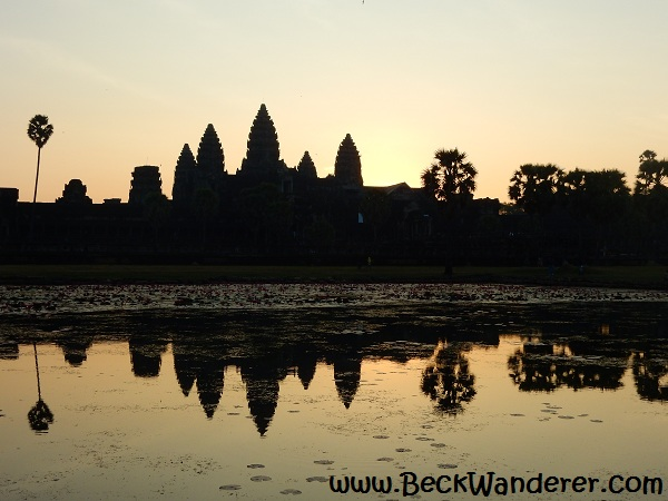 Sunrise at Angkor Wat, with reflection in lake