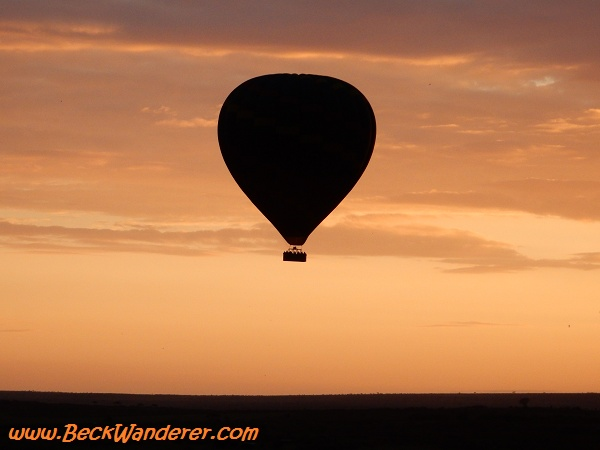 Hot air balloon silhouette at sunset
