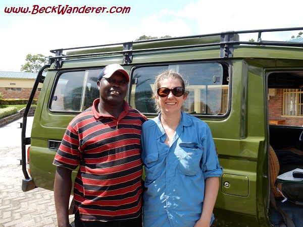 My driver in front of jeep, Volcanoes National Park, Rwanda