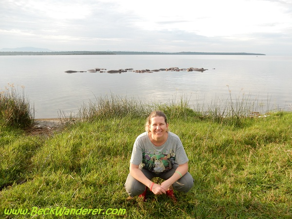A photo of me crouching in front of hippos, Kazinga Channel, Queen Elizabeth National Park