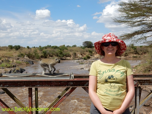 A oicture of me at the Mara River with a monkey running behind