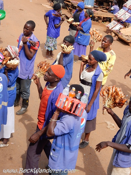 Ugandan roadside Sellers, all in blue as advertising Pepsi