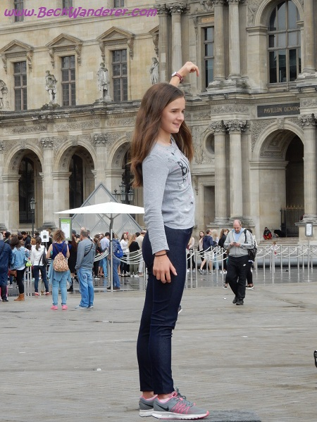 Photo of girl holding the Lourve