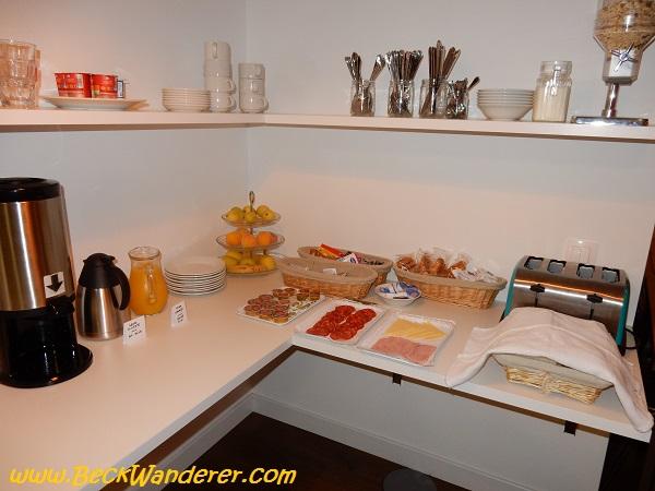 Europen Breakfast of bread, ham, cheese and fruit